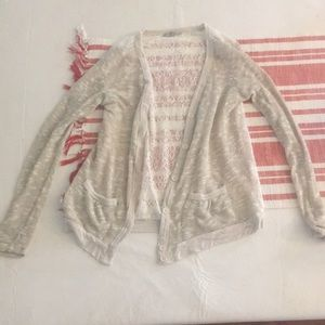 Small lace gold cardigan with buttons and pockets